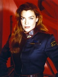 Claudia Christian Portrait in Red Background Photo by  Movie Star News