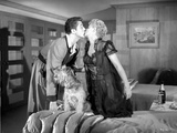 Behave Yourself Man in Grey Suit with Terrier on Bed Kissed the Woman in Black Dress Photo by  Movie Star News