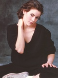 Ally Sheedy sitting on the Floor wearing Black Shirt and a Pair of Sneakers in Portrait Photo by  Movie Star News