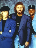 Bee Gees Band Members in Blue Suit and Denim Jacket with Black Flat Cap and Flat Top Cap Photo by  Movie Star News