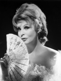 Arlene Dahl posed in Furry Dress with Fan Photo by  Movie Star News