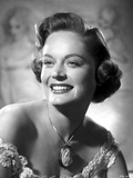 Alexis Smith smiling and wearing a Necklace with Big Pendant Photo af Movie Star News
