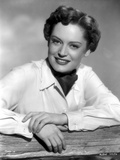 Alexis Smith Leaning on a Fence wearing White Long Sleeves Photo by  Movie Star News