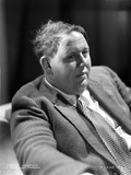 Charles Laughton sitting in Classic Photo by  Movie Star News