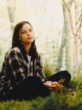 Alison Elliott sitting on Grass in Checkered Long Sleeves Photo by  Movie Star News