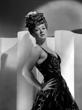 Claire Trevor Leaning on Wall, wearing Black Dress with Hand on Hips Photo by  Movie Star News