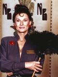 Cloris Leachman Posed in Blue Long Sleeve while Holding a Feather Duster Photo by  Movie Star News