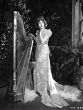 Corrinne Griffith on a Lace Gown with Harp Photo by  Movie Star News