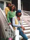 Bee Gees Band Group Picture standing on the White Staircase in Green, Yellow and White Long Sleeves Photo by  Movie Star News