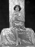 Corrinne Griffith on a Printed Dress and sitting Photo by  Movie Star News