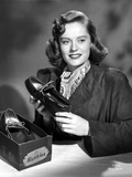 Alexis Smith Holding a Shoe while smiling in a Classic Portrait Photo by  Movie Star News