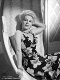 Eva Gabor on Printed Dress sitting Photo by  Movie Star News