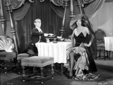 Bebe Daniels Having a Dinner with a Man in Black Strap Dress with Hands Laid on the Waist Photo by  Movie Star News