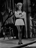 Betty Grable Posed with Arms Crossed in White Ruffle Dress with Black Ribbon and Black Shoes Photo by  Movie Star News