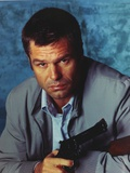 Harry Hamlin Portrait in Grey Coat with a Pistol Photo by  Movie Star News