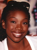 Brandy smiling with Sunglasses on Head Close Up Portrait Photo by  Movie Star News