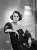 Frances Dee posed in Black Dress On A Couch in Black and White Photo by  Movie Star News