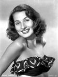 Brenda Marshall on a Printed Tube Top smiling Portrait Photo by  Movie Star News
