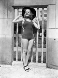 Betty Grable Posed with Hands on the Hat in Black Round Hat and One Piece Swimsuit with Black Flats Photo by  Movie Star News