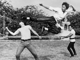 Bruce Lee Floating and Kicking a Man Photo by  Movie Star News