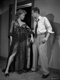 Human Desire Man in Polo and Tie Holding a Woman in Dress Photo by  Movie Star News