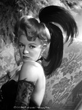 Claire Trevor Posed Sideways in Black Dress with Feather Headband Photo by  Movie Star News