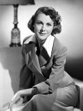 Frances Dee smiling in Formal Outfit in Black and White Photo by  Movie Star News