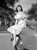 Dorothy Malone on a Ruffled Dress sitting on a Vintage Car Photo by  Movie Star News