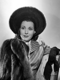 Frances Dee smiling in Fur Coat in A Portrait in Black and White Photo by  Movie Star News