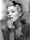 Claire Trevor Putting lipstick in Dress with Ring Photo by  Movie Star News