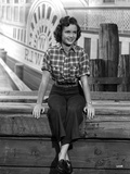 Debbie Reynolds wearing Plaid Top and Black Plants Photo by  Movie Star News
