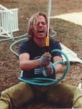 David Spade Holding a Water Hose Photo af  Movie Star News