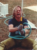 David Spade Holding a Water Hose Photo by  Movie Star News