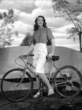 Dorothy Malone on a Printed Top and Holding a Bicycle Photo by  Movie Star News