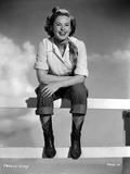 Colleen Gray on a Vintage Cowboy Attire sitting on Fence Photo by  Movie Star News
