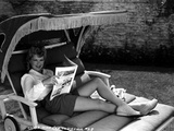 Claire Trevor Reclining on Couch, wearing White Long Sleeve with Magazine Photo by  Movie Star News