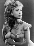 Gloria DeHaven posed On A Pole in Fancy Dress in Black and White Photo by  Movie Star News