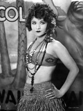 Betty Compson Posed with Hands on the Waist in Tube Bra and Knitted Straw Skirt with Bead Necklaces Photo by  Movie Star News