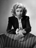 Gloria DeHaven Looking Serious Leaning On A Chair in Formal Dress in Black and White Photo by  Movie Star News