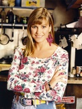 Cynthia Geary in a Floral Top smiling and standing Portrait Photo by  Movie Star News