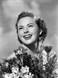 Colleen Gray Surrounded with Flowers Portrait Photo by  Movie Star News