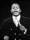 Flip Wilson smiling in Black With Microphone Photo by  Movie Star News