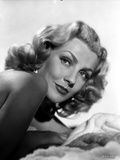 Dolores Moran sitting Portrait Photo by  Movie Star News