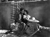 Bebe Daniels Leaning Back on the Man's Chest while Holding a White Sombrero in White Blouse and Flo Photo by  Movie Star News