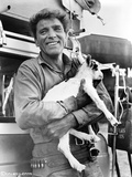 Burt Lancaster in Long Sleeve Polo Carrying an Animal Photo by  Movie Star News