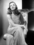 Ella Raines on a Dress sitting Photo by  Movie Star News