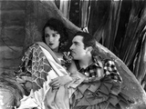 Bebe Daniels Leaning Back on the Wall with a Man in White Floral Dress Photo by  Movie Star News