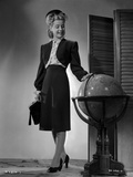 Gloria DeHaven posed in Forma Outfit Touching A Globe in Black and White Photo by  Movie Star News