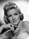 Claire Trevor Looking Away in White with Pearl Necklace Photo by  Movie Star News