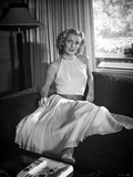 Dolores Moran on a Dress sitting Portrait Photo by  Movie Star News